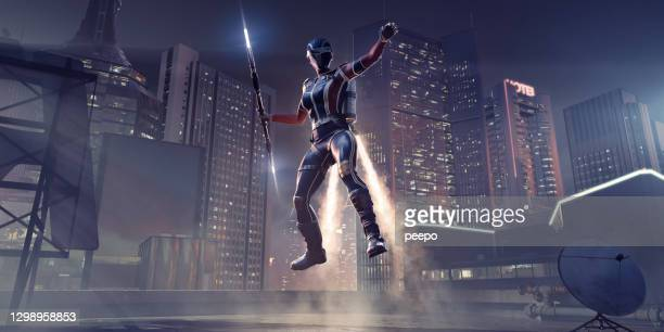 female jet pack superhero with staff lands on city rooftop - landing touching down stock pictures, royalty-free photos & images