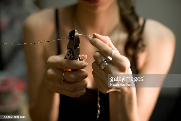 female jeweller cutting chain with pincers, close-up - jeweller stock pictures, royalty-free photos & images