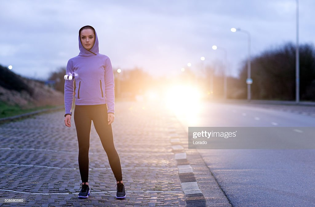 female jogger at winter evening outdoors : Stock Photo