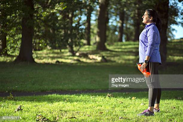 female jogger resting - fat lady in leggings stock photos and pictures