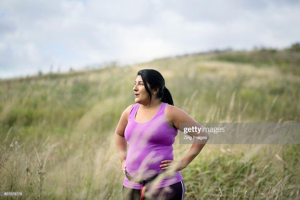 Female jogger resting : Stock Photo
