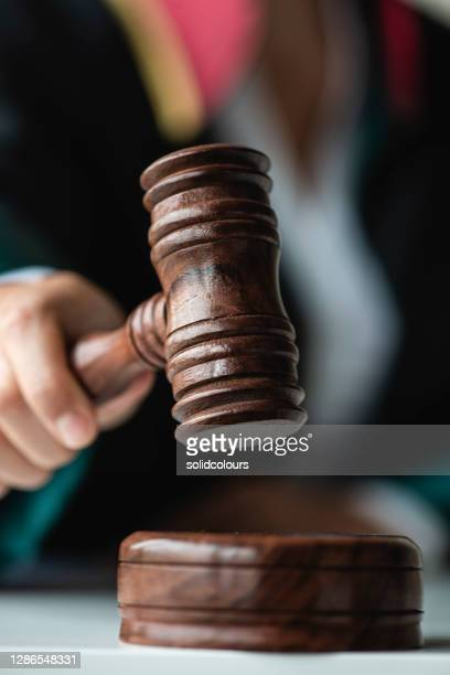 female judge holding gavel - judge law stock pictures, royalty-free photos & images