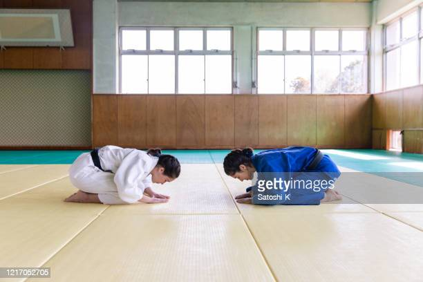 female judo athletes bowing before the match - martial arts stock pictures, royalty-free photos & images