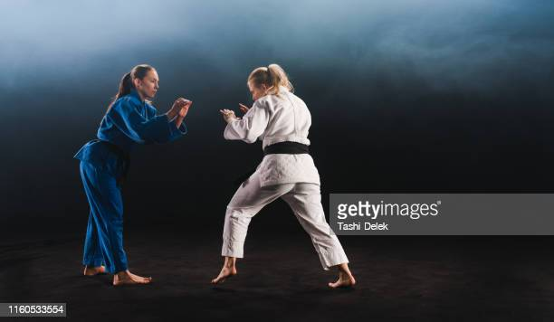 female judo players competing during match - judo stock pictures, royalty-free photos & images