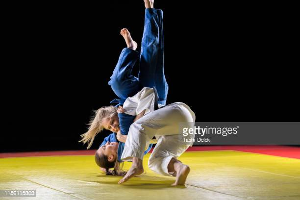 female judo players competing in judo match - judo stock pictures, royalty-free photos & images
