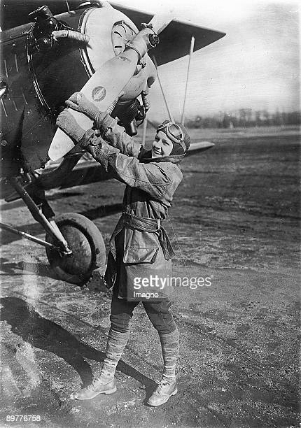 Female jump start This young woman was the very first female airport worker that helped pilotes to activate their airplanes Photograph Around 1930