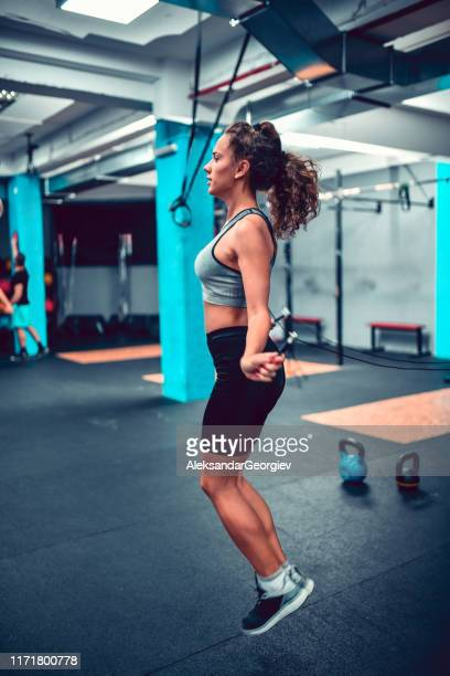 female jumping with rope in gym - skipping along stock photos and pictures