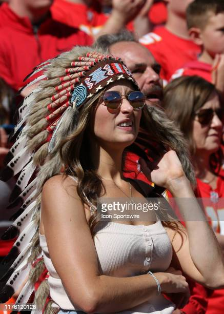 Female Kansas City Chiefs fan wears a headdress during an NFL matchup between the Houston Texans and Kansas City Chiefs on October 13, 2019 at...