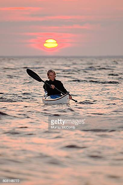 female kayaker at sunset - murray mccomb stock pictures, royalty-free photos & images