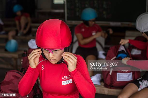 A female keirin student prepares for training at the Nihon Keirin Gakkou on July 8 2015 in Izu Japan Keirin is a form of cycle racing developed in...