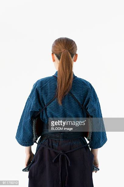 Female kendo player, rear view
