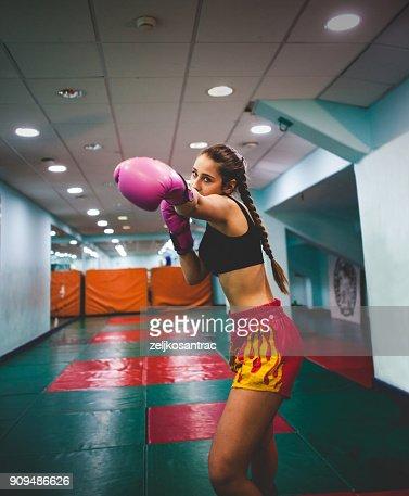 Female Kickboxer Fighter Training