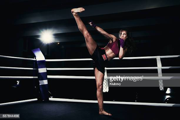 female kickboxer training in a boxing ring - muay thai stock pictures, royalty-free photos & images
