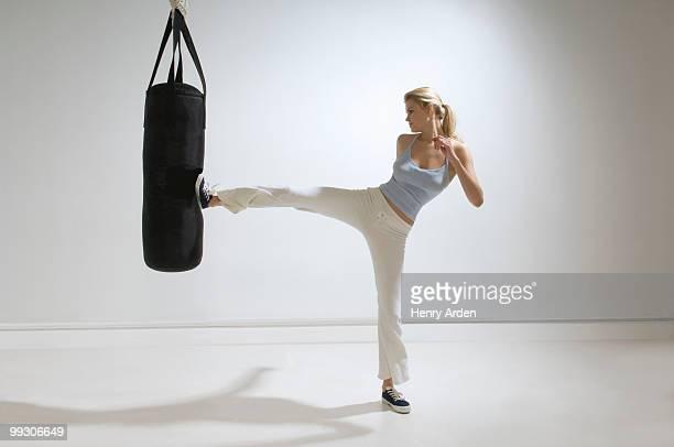 Female kicking punchbag