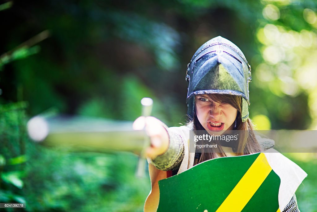 Female knight ordering her unit to charge : Stock Photo