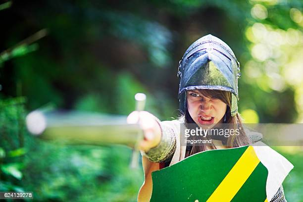 Female knight ordering her unit to charge