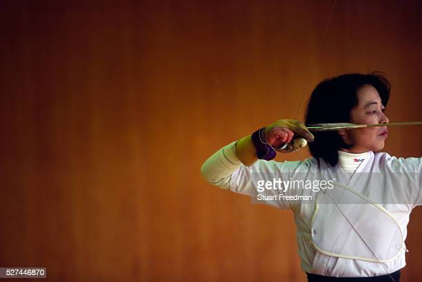 A female Kyodo practitioner at a Kyoto dojo Kyudo is a modern Japanese martial art derived from ancient Samurai archery and heavily influenced by Zen...