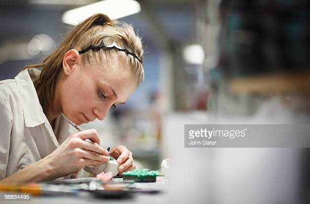 female lab technician working at bench