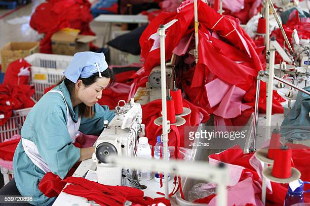 Female labors work in a cloth factory which export to European Union in Huaibei, Anhui province, East China on 13th October 2015. China's exports...