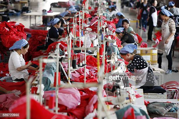 Female labors work in a cloth factory which export to European Union in Huaibei Anhui province East China on 13th October 2015 China's exports fell...