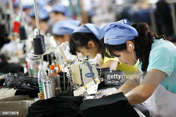 A female labour works in a textile clothes factory in Huaibei Anhui province east China on 1th September 2015 China's official manufacturing...