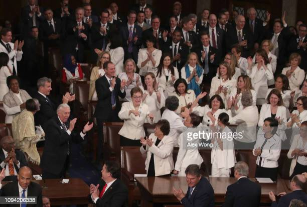 Female lawmakers cheer during President Donald Trump's State of the Union address in the chamber of the US House of Representatives at the US Capitol...