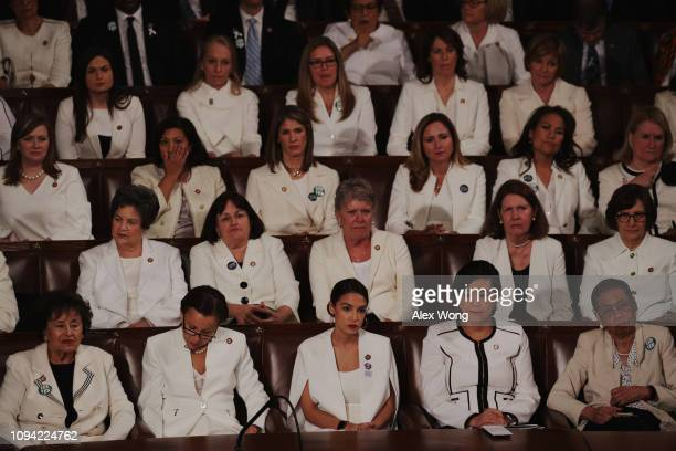 Female lawmakers dressed in white watch as President Donald Trump delivers the State of the Union address in the chamber of the US House of...