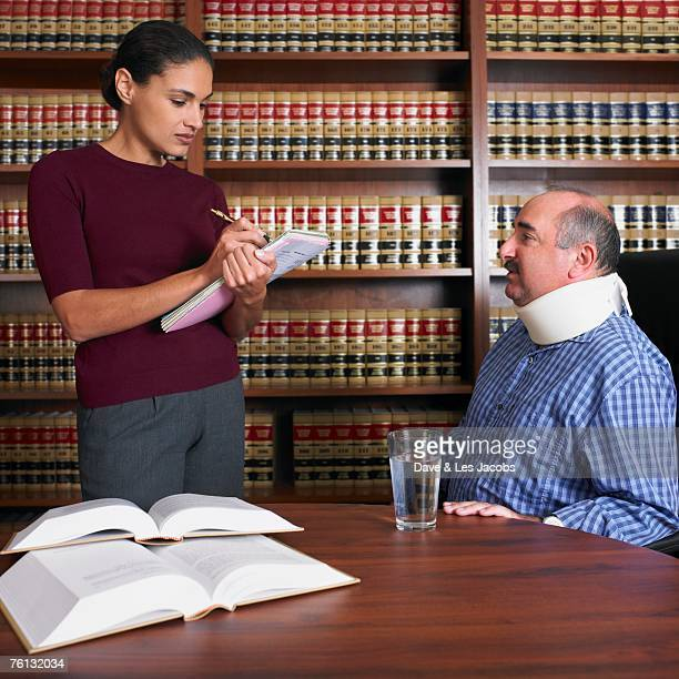 female lawyer talking to injured client - lawsuit stock pictures, royalty-free photos & images