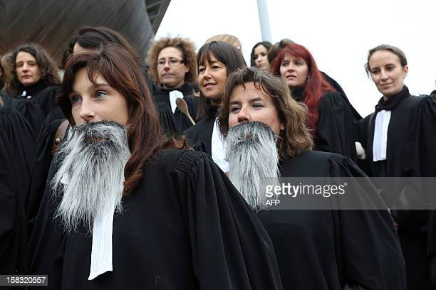 Female lawyers protest in front of Bordeaux's courthouse with beards and kitchen utensils on December 13 2012 to protest against sexist remarks of a...