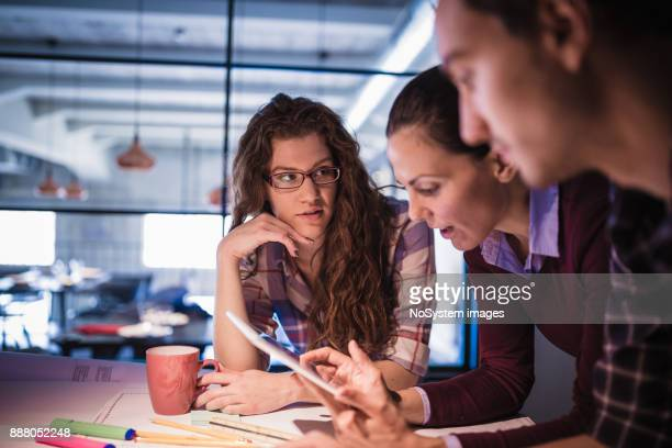 Female Leaders. Group of young architects working together in architecture studio