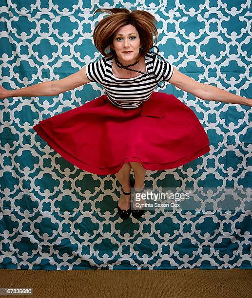 female leaping in stripes and skirt knees up - older women in short skirts stock pictures, royalty-free photos & images