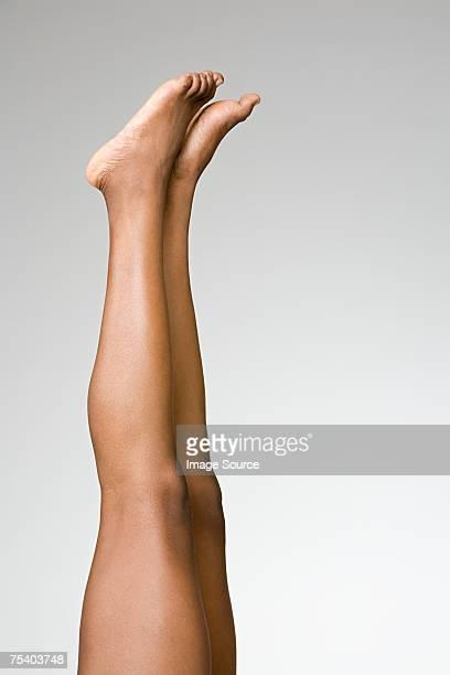 Weibliche Beine und Füße