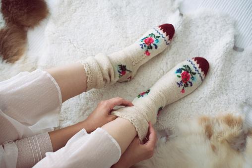 Female legs in knitted socks - gettyimageskorea