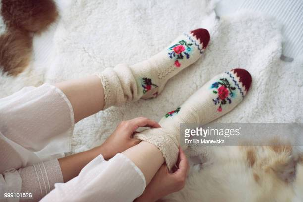 female legs in knitted socks - レッグウォーマー ストックフォトと画像