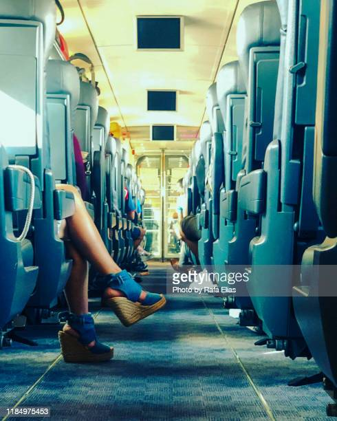 female legs in train car, fashion shoes - alta velocidad espanola stock pictures, royalty-free photos & images