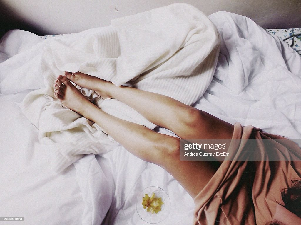 Female Legs On Bed : Stock Photo