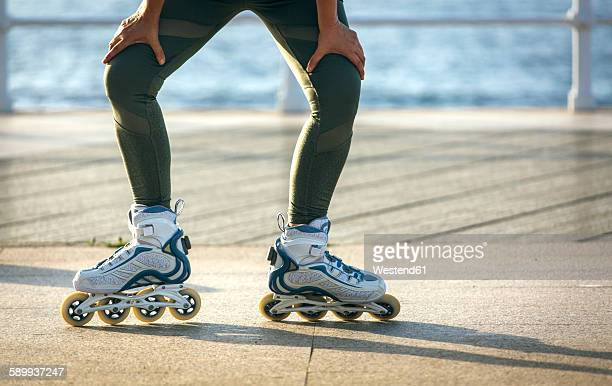female legs skating - inline skating stock pictures, royalty-free photos & images