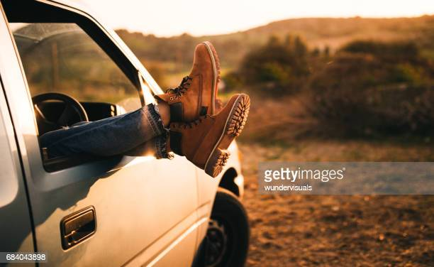 female legs sticking out of a pick-up truck window - pick up truck stock pictures, royalty-free photos & images