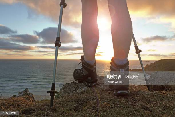 female legs with hiking boots looking out to see - mature women stock pictures, royalty-free photos & images
