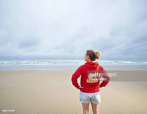 Female life guard looking out to sea.
