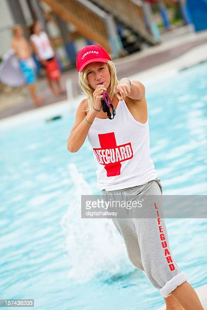 female lifeguard pointing - lifeguard stock pictures, royalty-free photos & images