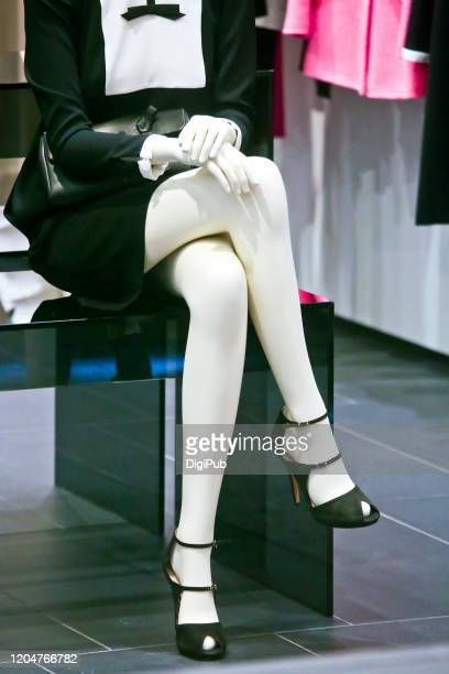 female like mannequin sitting in chair - model organism stock pictures, royalty-free photos & images