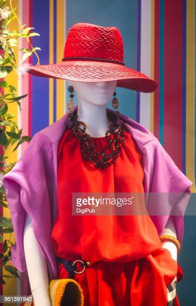 Female like mannequin wearing clothes and straw hat