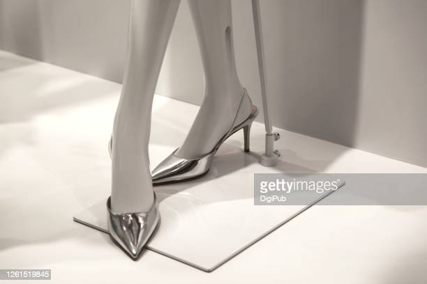 female like mannequin wearing silver shoes - silver shoe stock pictures, royalty-free photos & images