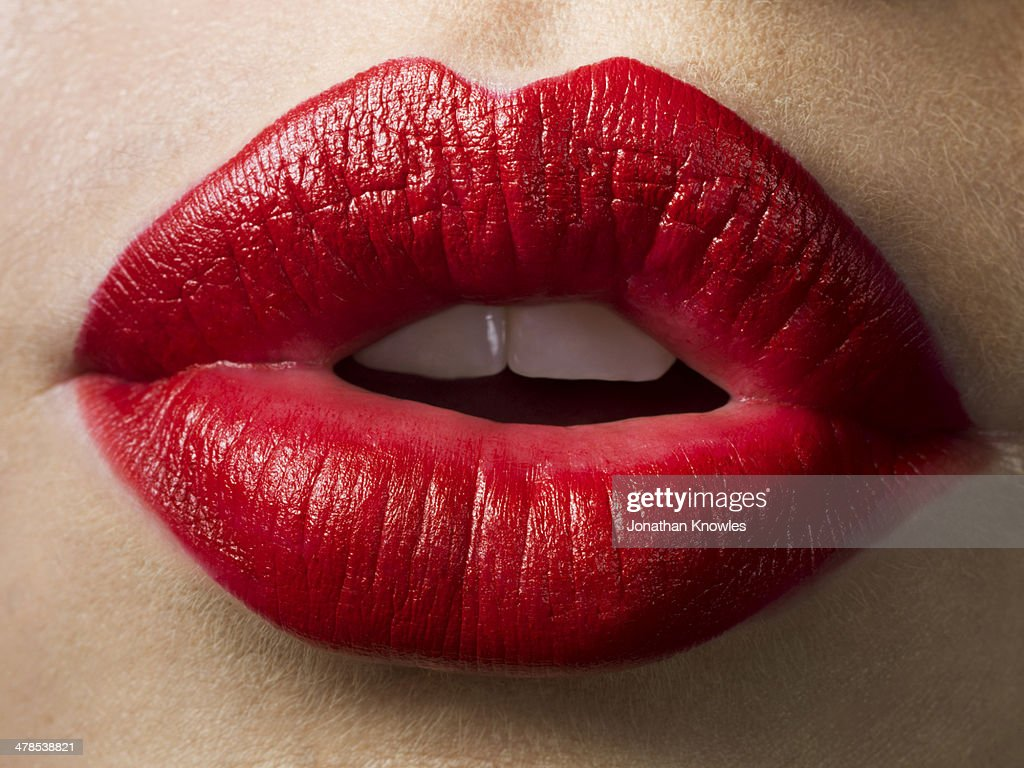 Female lips with red lipstick on, close up : Stock Photo
