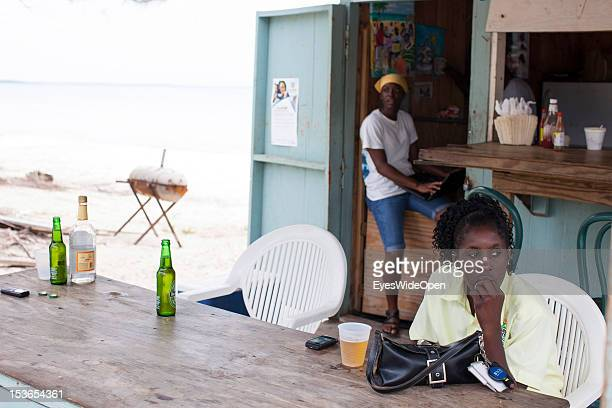 A female local bahamian guest a young lady is having a drink at a foodstall at New Bight Beach on June 15 2012 in Cat Island The Bahamas
