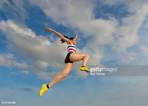female long jump athlete in action - long jump stock pictures, royalty-free photos & images