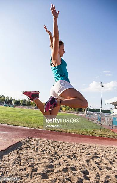 female long jumper mid-air - women's field event stock pictures, royalty-free photos & images