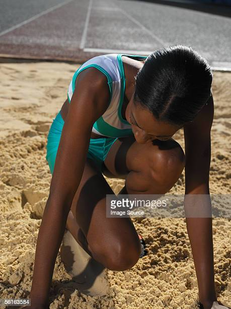 female long jumper - women's field event stock pictures, royalty-free photos & images