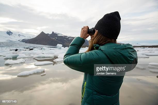 A female looking at a glacier.